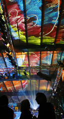 People attend party in a illuminated  former power plant during the 'Popkomm' international music trade fair in Berlin