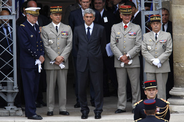 France's Defence Minister Herve Morin stands with France's army Chief of Staff Georgelin as France pays tribute to soldiers killed in an ambush in Afghanistan