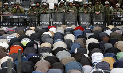 Israeli police and Palestinians scuffle in Arab East Jerusalem