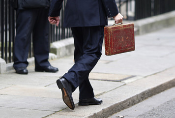 Britain's Chancellor of the Exchequer Darling holds Gladstone's old Budget box outside 11 Downing Street in central London