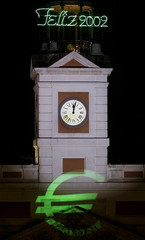 EURO SYMBOL IS PROJECTED ONTO CLOCK OF MADRID'S CENTRAL PUERTA DEL SOL.
