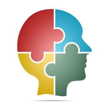 The color human head composed of red, blue, green and yellow puzzle pieces with gray shadow below the head on a white background. Human head composed of geometric elements