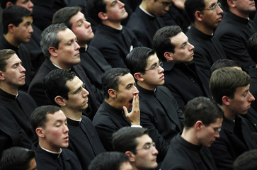 Priests attend Pope Benedict XVI's weekly audience in the Paul VI hall at the Vatican