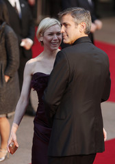 """Actors George Clooney and Renee Zellweger arrive for the European premiere of """"Leatherheads"""" at the Leicester Square Odeon cinema in London"""