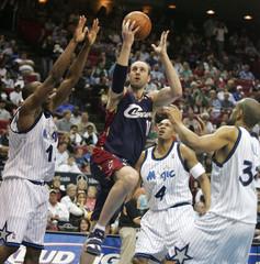 Cavaliers' Ilgauskas drives against Orlando Magic defense during NBA play in Orlando