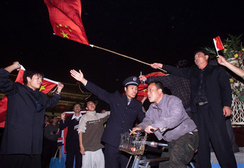 CHINESE POLICE CONTROL SOCCER FANS ARRIVING AT BEIJING TIANANMENSQUARE.