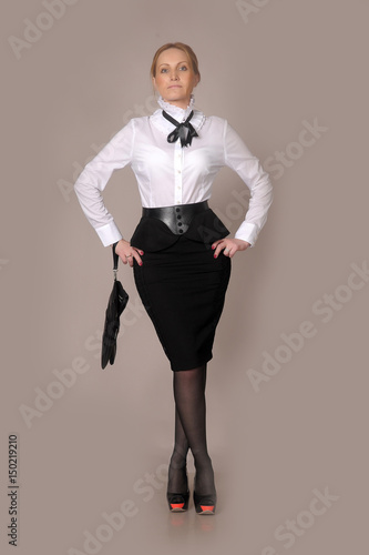 02688c9814 business woman in a white blouse and black skirt