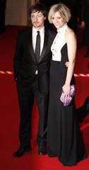 British actor McAvoy and his girlfriend Duff arrive at the BAFTA awards ceremony in London