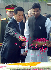 CHAIRMAN JIA QINGLIN OF THE CHINESE PEOPLES POLITICAL CONSULTATIVECONFERENCE SCATTERS ROSE PETALS IN ...