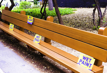 Wet Paint Sign on Bench in a Public Garden