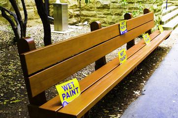Wet Paint Sign on a Public Garden Bench