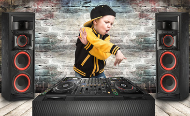 The little boy in the style of Hip-Hop .Cool rap dj. Children's fashion.Cap and jacket. The Young Rapper.