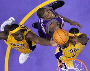 Lakers' Parker and Brown grab rebound ahead of Suns' Bell during Game 3 of NBA Western Conference first round playoff series in Los Angeles