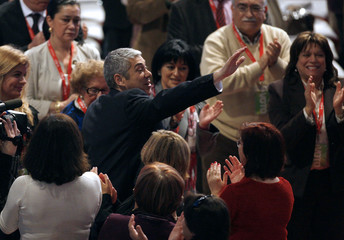 Portugal's Prime Minister Jose Socrates is welcomed by comrades upon his arrival at the Socialist Party congress in Espinho