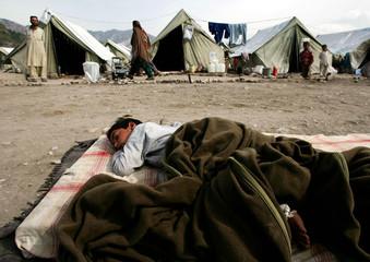 Kashmiri refugee rests outside a tent at the Kastra camp in Ghari Habibulla village