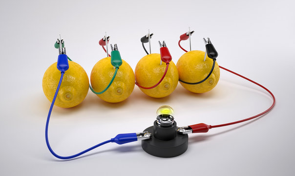 Electricity From Lemon battery on white background. Bio battery.