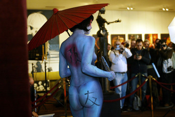 "-PHOTO TAKEN 15MAR03- A model, painted by Belgium's artist Hanna Balke and called ""Mi"", poses for ph.."