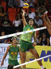 Brazil's Rodrigo Santana spikes the ball during their World League 2009 men's volleyball match against Venezuela in Caracas