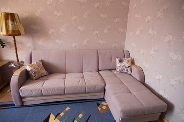 Sofa in a room with TThis