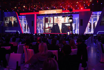 Former Chancellor Kohl is pictured on a large screen as he is presented with his Millennium Bambi award during the 61st Bambi media awards ceremony in Potsdam