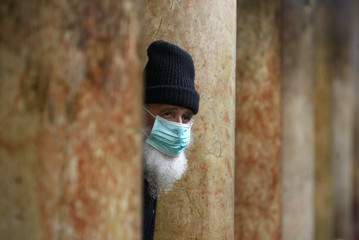 A Greek Orthodox priest walks inside the Church of Nativity in Bethlehem