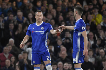 Chelsea's John Terry is given the captains armband by Gary Cahill after coming on as substitute
