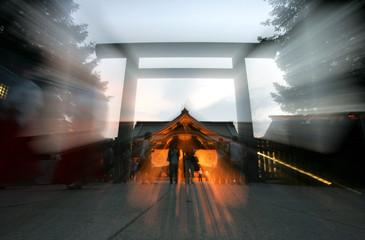 People visit Yasukuni Shrine in Tokyo to offer prayers for war dead.