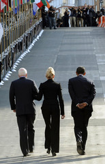 U.S presidential nominees Obama and McCain and NYC Mayor Bloomberg ascend ramp from Ground Zero in New York