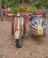brightly painted motor scooter with side-car