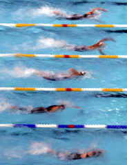 Athletes swim during the women's 50 metres freestyle race at the European Short Course Swimming ...