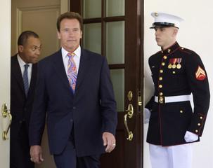 California Gov. Arnold Schwarzenegger walks out of the White House in Washington