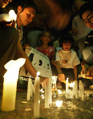 Jordanians light candles during a sit-in candle light vigil outside the United Nations office in Amman.