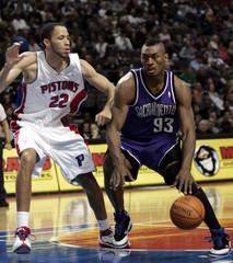 Sacramento Kings' Ron Artest drives around Detroit Pistons' Tayshaun Prince during their NBA game in Auburn Hills