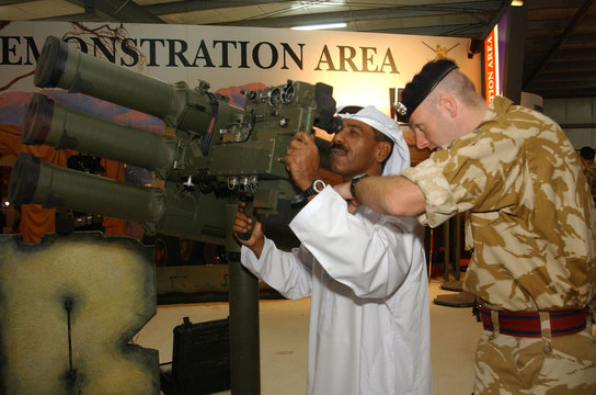 UAE MILITARY STUDENTS TRYOUT LASER GUN SIGHT EQUIPMENT AT IDEXEXHIBITION IN ABUDHABI.