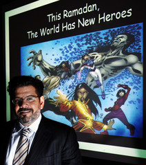 Founder and CEO Al-Mutawa poses in front of cartoon characters created by his publishing company Teshkeel in Medford
