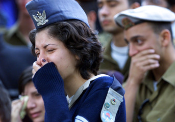 FRIENDS OF SOLDIER SLAIN IN BOMBWING WEEP AT HIS FUNERAL IN JERUSALEM.