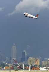 AMERICA WEST FLIGHT TAKES OFF OVER NEW YORKS CHANGED SKYLINE.