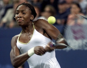 VENUS WILLIAMS RETURNS THE BALL TO HER SISTER SERENA DURING THE WOMENS US OPEN FINAL.