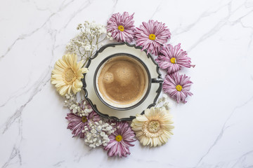 Coffee cup and spring flowers, studio shot
