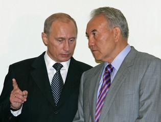Russian President Putin talks to Kazakh President Nazarbayev in Astana.