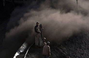 Afghan miners work at the Karkar coal mine in Pul-i-Kumri