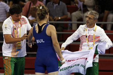 Elina Vaseva of Bulgaria talks to her coach during the women's 63kg freestyle wrestling competition against Maria Dunn of Guam at the Beijing 2008 Olympic Games August