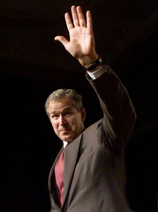 Texas Governor and Republican presidenital hopeful George W. Bush waves to the audience after delive..