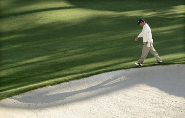 Chris DiMarco walks back to ball after checking pin on tenth hole of Masters tournament third round.