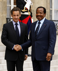 France's President Nicolas Sarkozy welcomes Cameroon's President Paul Biya before a meeting at the Elysee Palace in Paris