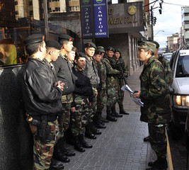 Armed Paraguayan soldiers keep watch in front of a hotel in Asuncion