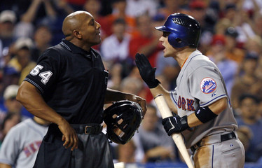 New York Mets David Wright argues a called third strike with home plate umpire C B Bucknor while playing against the Philadelphia Phillies in Philadelphia Pennsylvania