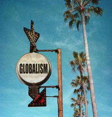 aged and worn vintage photo of globalism sign with palm trees