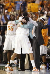 Tennessee guard Candace Parker hugs coach Pat Summitt after Tennessee defeated Stanford to win the NCAA Women's championship basketball game