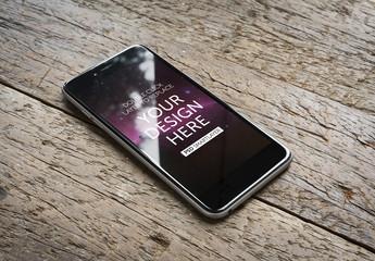 Smartphone on Wooden Background Mockup 1